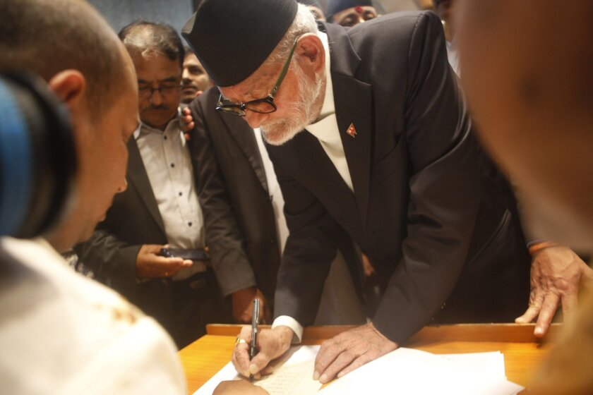 FILE - In this Friday, Sept. 18, 2015 photo, Nepalese Prime Minister Sushil Koirala signs the constitution document in the Constituent Assembly hall in Kathmandu, Nepal. The former Nepalese prime minister and leader of nation's largest political party, has died in Kathmandu. He was 78. (AP Photo/Ni