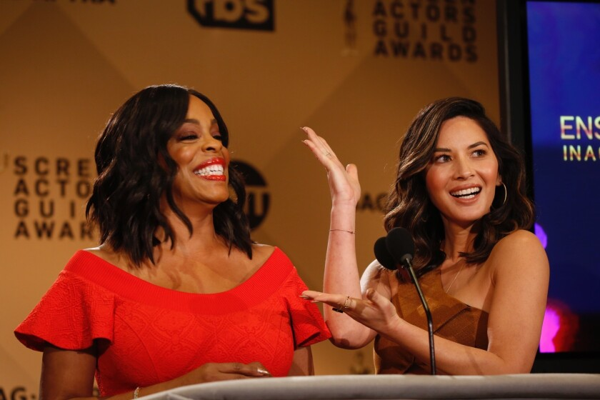 Niecy Nash, left, and Olivia Munn announce the nominations for the 24th Screen Actors Guild Awards in West Hollywood on Dec. 13, 2017.