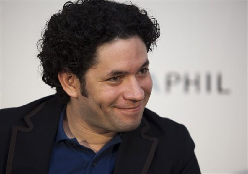 Conductor Gustavo Dudamel is presented to the media on his first official day as Music Director of the Los Angeles Philharmonic during a media briefing at the Walt Disney Concert Hall on Wednesday, Sept. 30, 2009 in Los Angeles. Dudamel�s first Los Angeles concert will take place on Thursday, Oct. 8. Dudamel will conduct a special Los Angeles Philharmonic event at the Hollywood Bowl on Saturday, Oct. 3. (AP Photo/Damian Dovarganes)