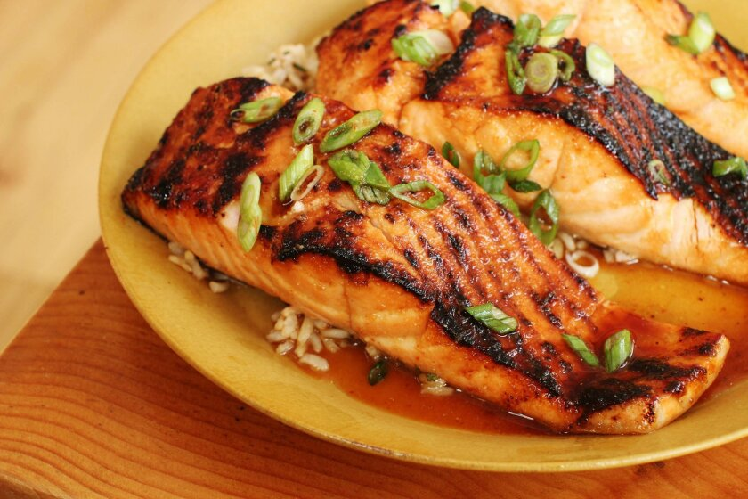 This Feb. 1, 2016, photo, shows teriyaki sauce on salmon in Concord, N.H. This incredibly versatile and delicious teriyaki sauce recipe can be used on whatever protein at hand: chicken, steak, pork or salmon. (AP Photo/Matthew Mead)