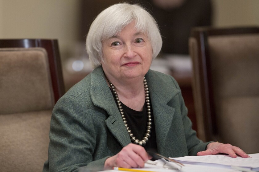Federal Reserve Chairwoman Janet L. Yellen arrives to an open meeting of the central bank's Board of Governors.