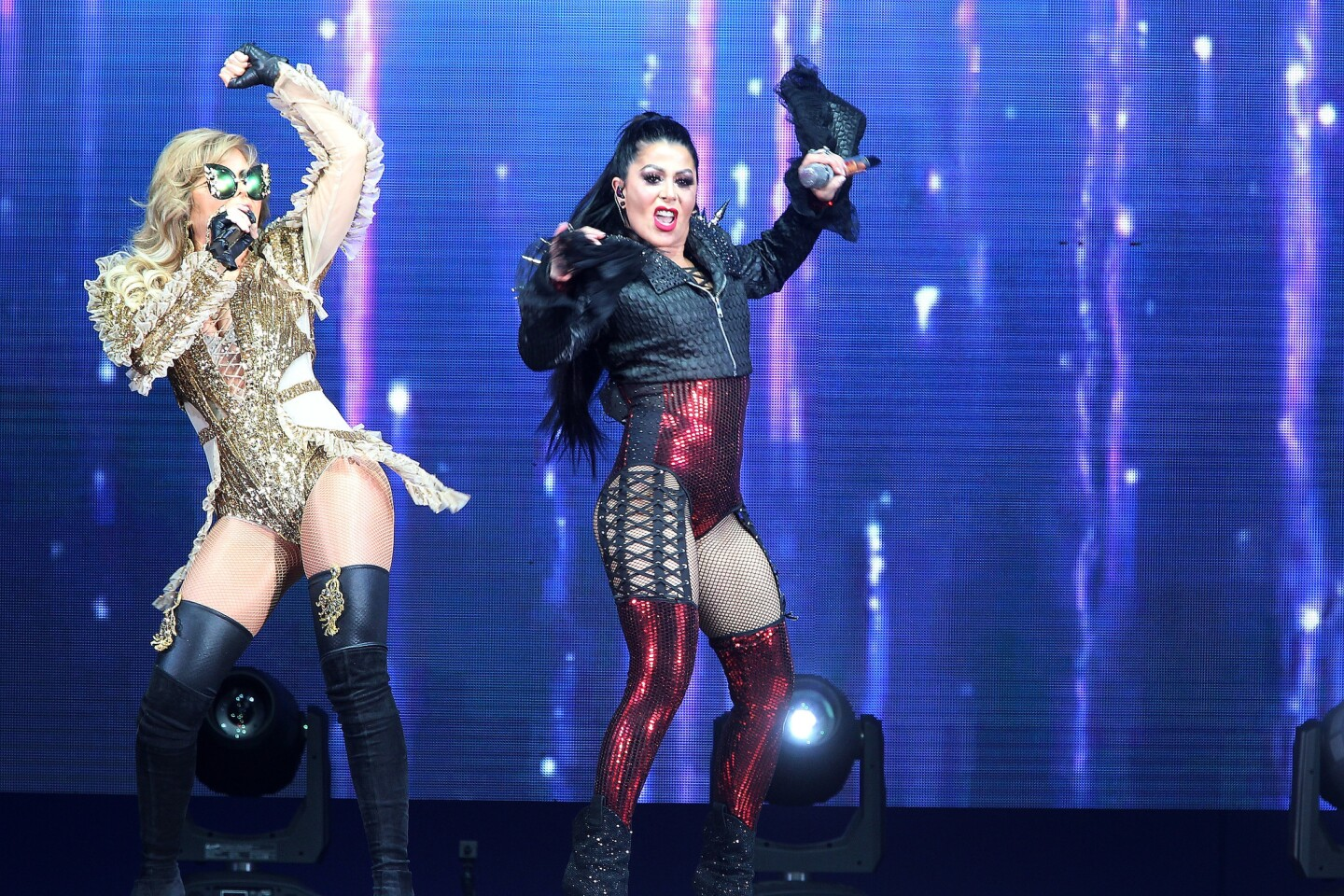 """Gloria Trevi, Alejandra Guzman perform onstage during the """"Versus Tour"""" at Hollywood Bowl on April 14, 2018 in Hollywood, CA. (Photo by © Art. Garcia/DDPixels.com)"""