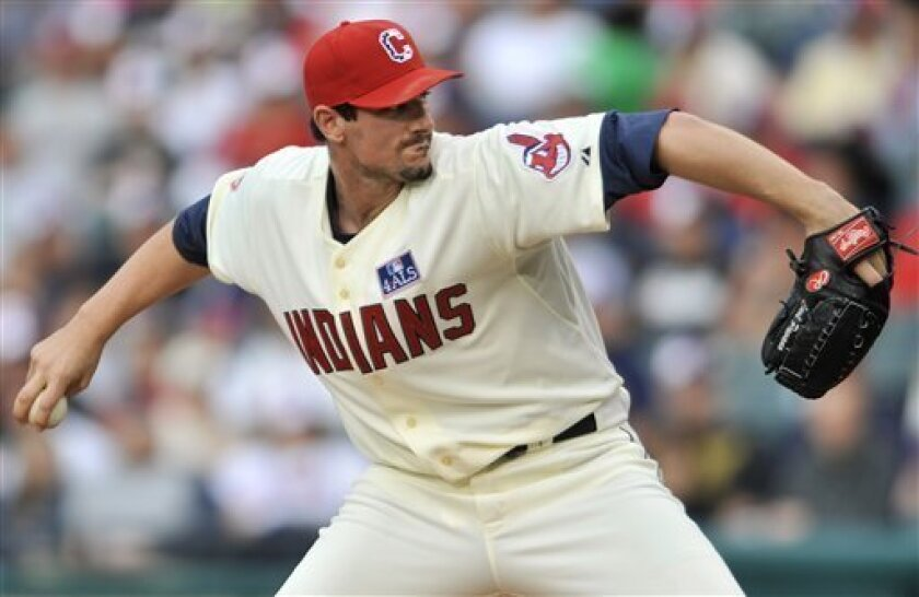 Cleveland Indians pitcher Carl Pavano delivers against the Oakland Athletics in the first inning of a baseball game on Saturday, July 4, 2009, at Progressive Field in Cleveland, Ohio. (AP Photo/David Richard)