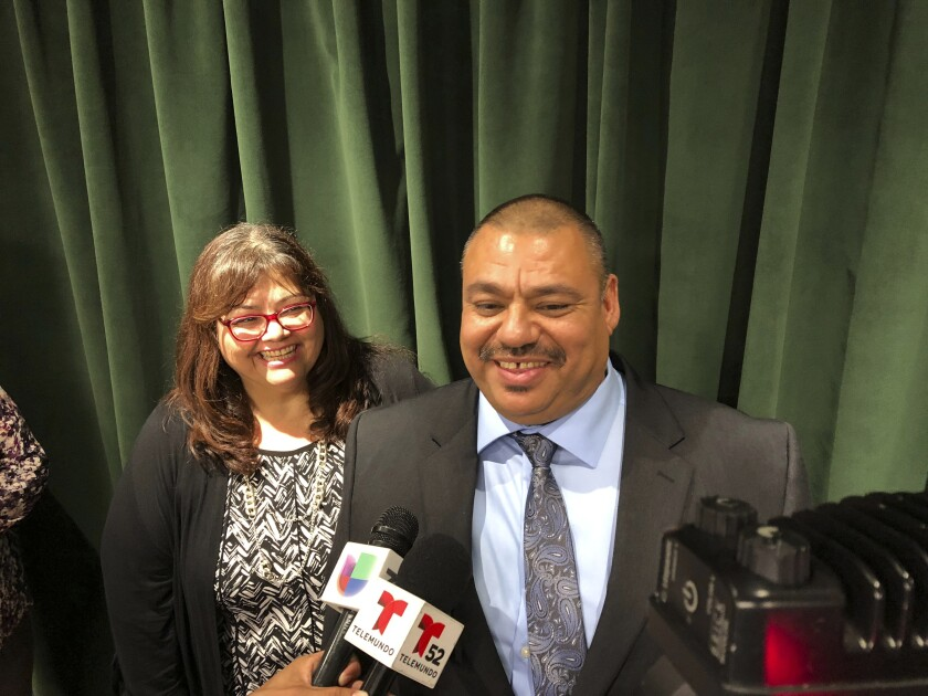 Ruben Martinez Jr., right, and his wife, Maria, left, talk to reporters at the Hall of Justice in downtown Los Angeles, on Tuesday, Nov. 12, 2109. Martinez walked from Los Angeles Superior Court a free man on Tuesday after prosecutors reviewed his unwavering claim of innocence and agreed he had been wronged. (AP Photo/Brian Melley)