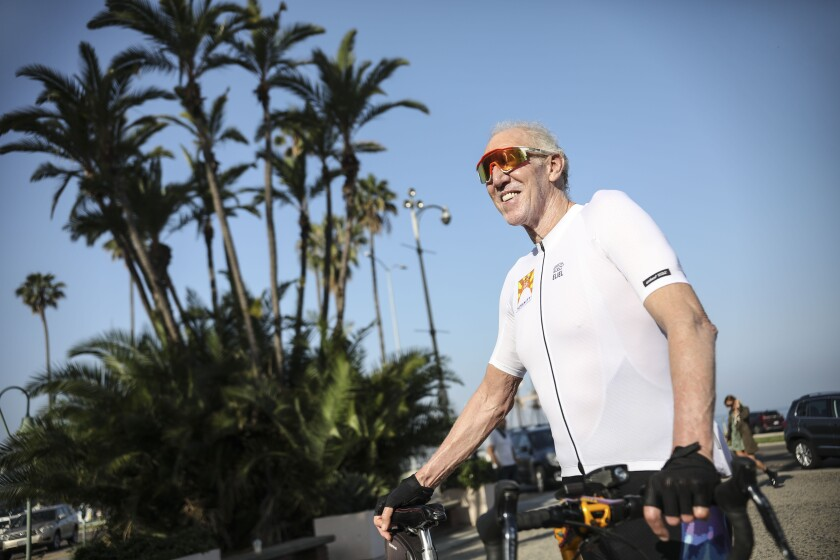 Former NBA star Bill Walton prepares to ride his bike along Harbor Drive during the Bike for Humanity on Saturday, April 25, 2020.