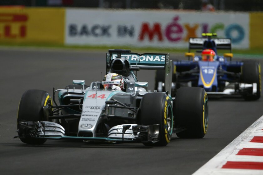 Mercedes driver Lewis Hamilton of Britain steers his car followed by Sauber driver Felipe Nasr of Brazil during the third practice session for the Formula One Mexico Grand Prix auto race at the Hermanos Rodriguez racetrack in Mexico City, Saturday, Oct. 31, 2015. (AP Photo/Eduardo Verdugo)