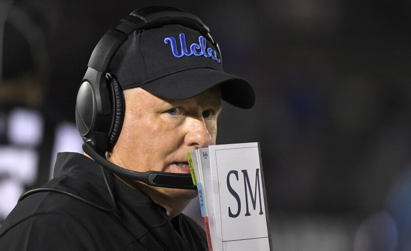 UCLA coach Chip Kelly stands on the sideline during a game against California on Nov. 30.