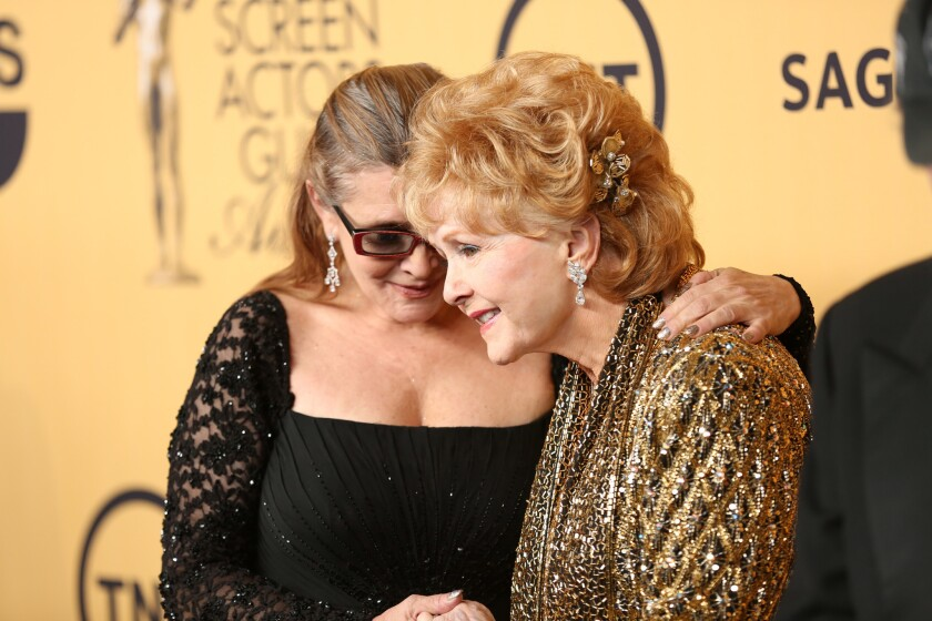 Debbie Reynolds with daughter Carrie Fisher at the Screen Actors Guild Awards at the Shrine Auditorium in Los Angeles on Jan. 25, 2015.