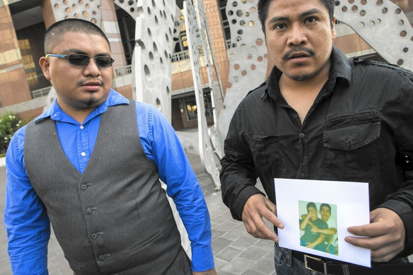 Eutiquio Acevedo Mendez, left, who was wounded in the Gardena police shooting that left Ricardo Diaz Zeferino dead, and Diaz Zeferino's brother, Agustin Reynoso, at a news conference Wednesday.