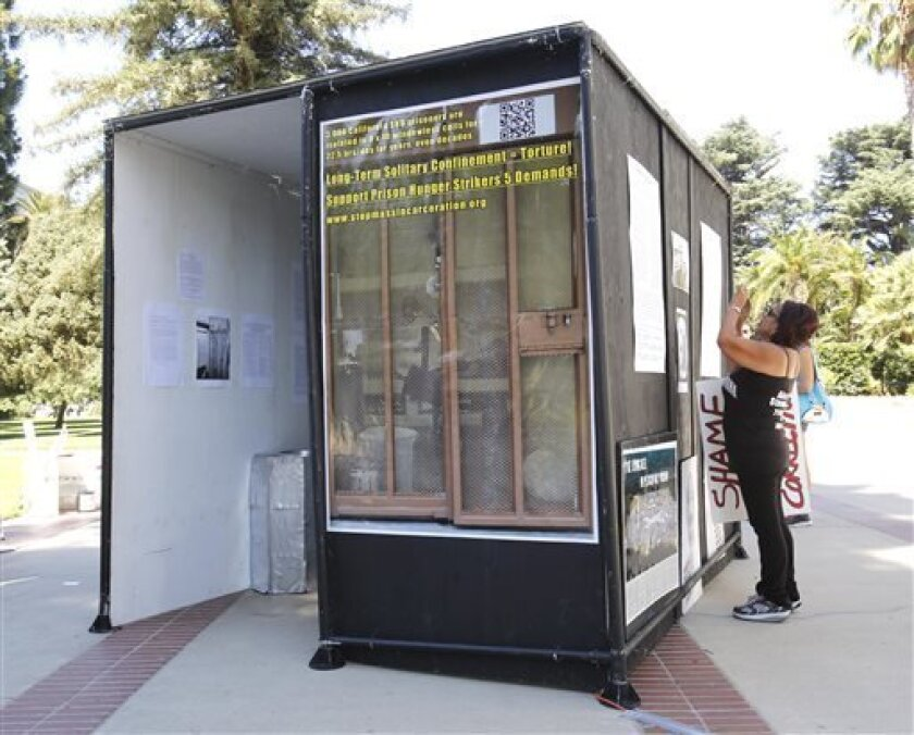 In this Wednesday Aug. 14, 2013, a life-sized replica of a Secure Housing Unit cell, is displayed at rally calling for the end of solitary confinement in California prisons, at the Capitol in Sacramento, Calif. California inmates have ended their nearly two-month hunger strike protesting the prison system's isolation policies, prison officials said Thursday, Sept. 5, 2013. All inmates began accepting prison-issued meals early Thursday, Corrections Secretary Jeffery Beard said.(AP Photo/Rich P