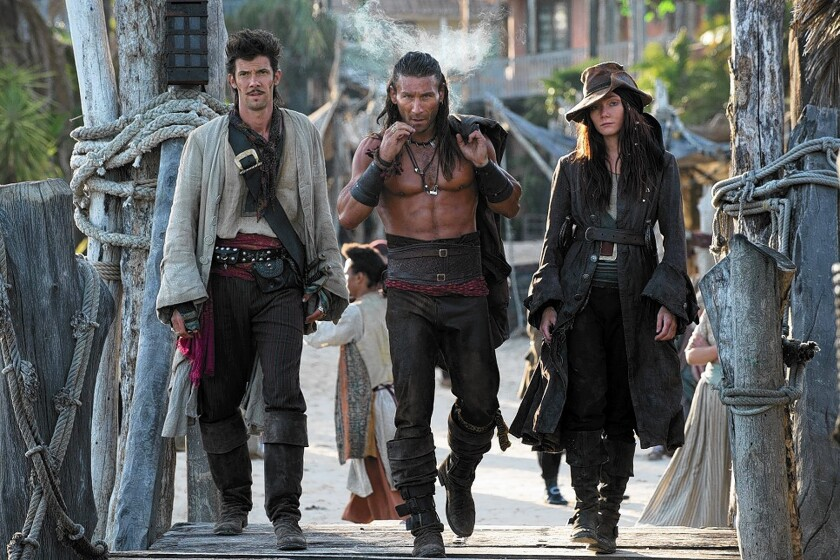 "Toby Schmitz, left, Zach McGowan and Clara Paget star in ""Black Sails."""
