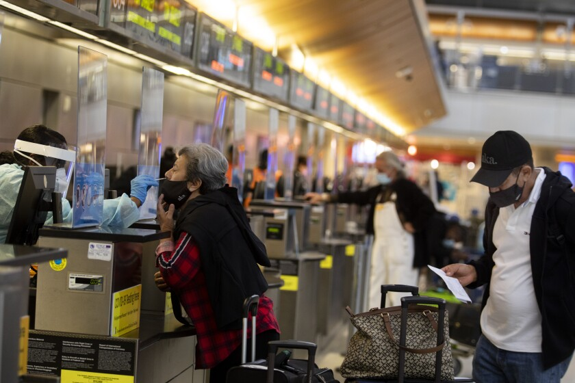 Passenger Ana Ramos is given a coronavirus test at LAX on Tuesday.