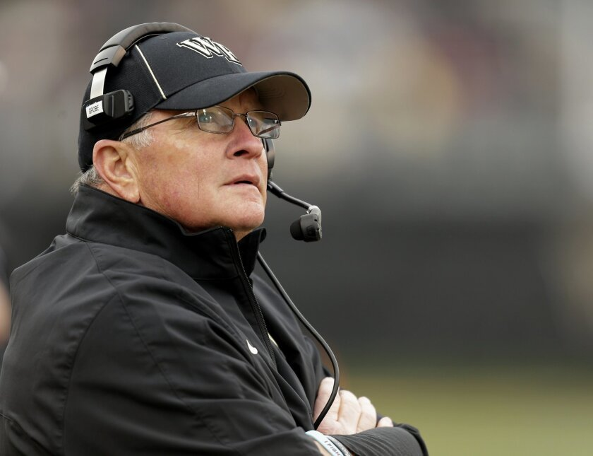 FILE - In this Nov. 9, 2013 file photo, Wake Forest head coach Jim Grobe looks at the scoreboard as his team plays Florida State in the second half of an NCAA college football game in Winston-Salem, N.C. Former Wake Forest coach Grobe will replace Art Briles, Baylor announced Monday, May 30, 2016. Grobe was named acting coach, with no mention of how long of a contract he will receive. (AP Photo/Nell Redmond, File)