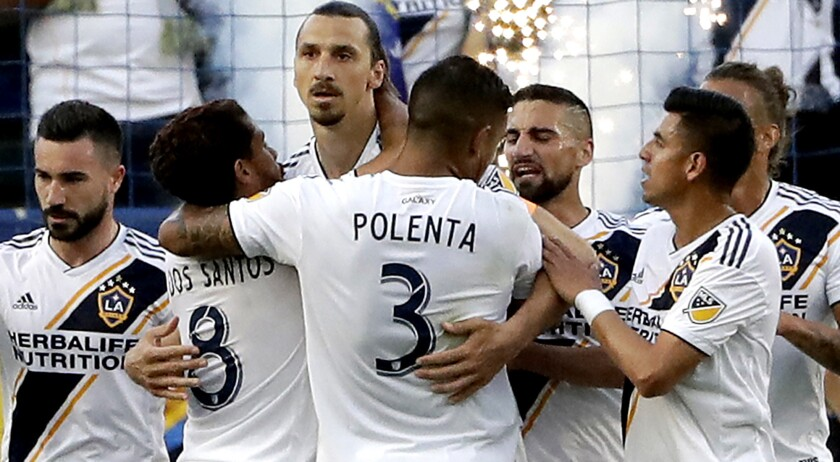 Galaxy forward Zlatan Ibrahimovic, center, is congratulated by teammates after scoring against the Timbers during the first half Sunday.