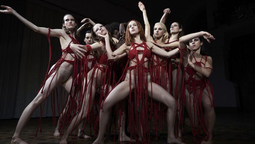 """Dakota Johnson, center, plays a dancer named Susie Bannion in """"Suspiria."""""""