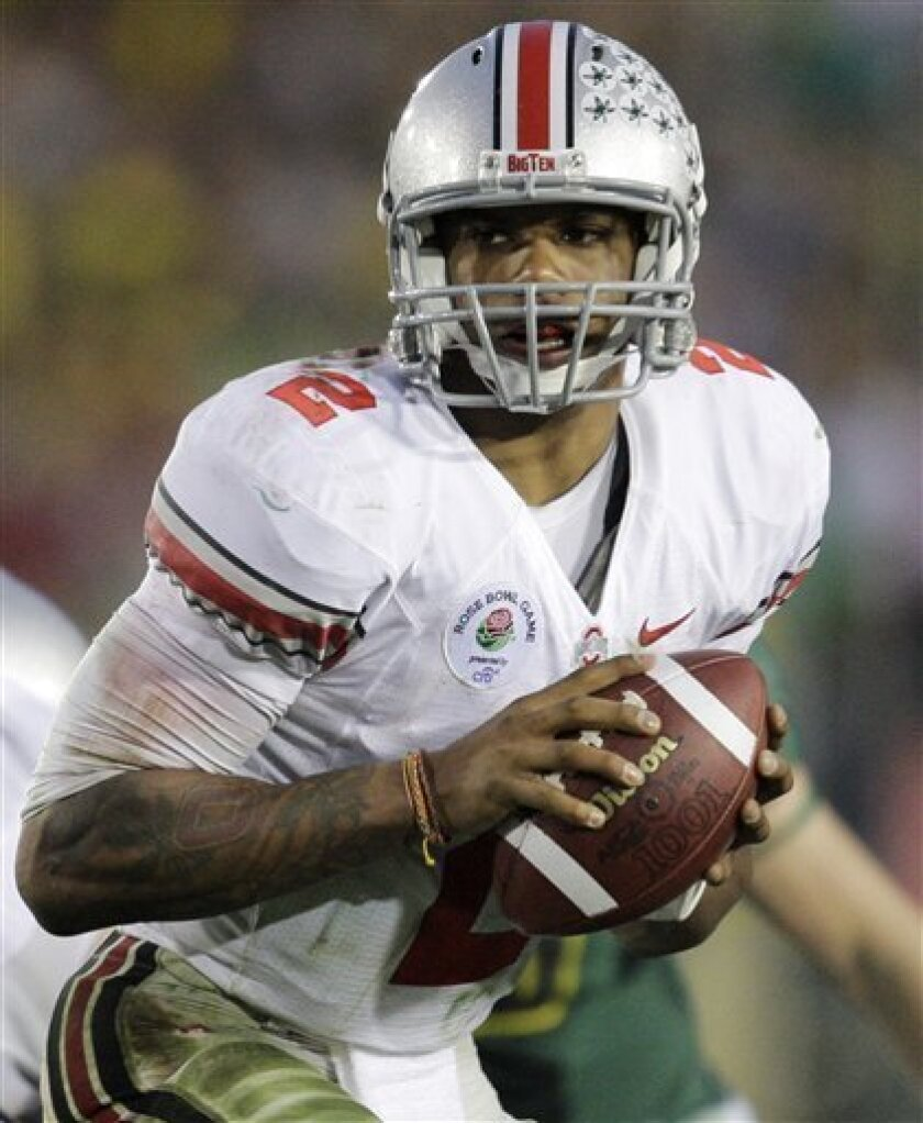 Ohio State's Terrelle Pryor runs a play against Oregon during the fourth quarter at the Rose Bowl NCAA college football game Friday, Jan. 1, 2010, in Pasadena, Calif. Ohio State won 26-17. (AP Photo/Jae C. Hong)