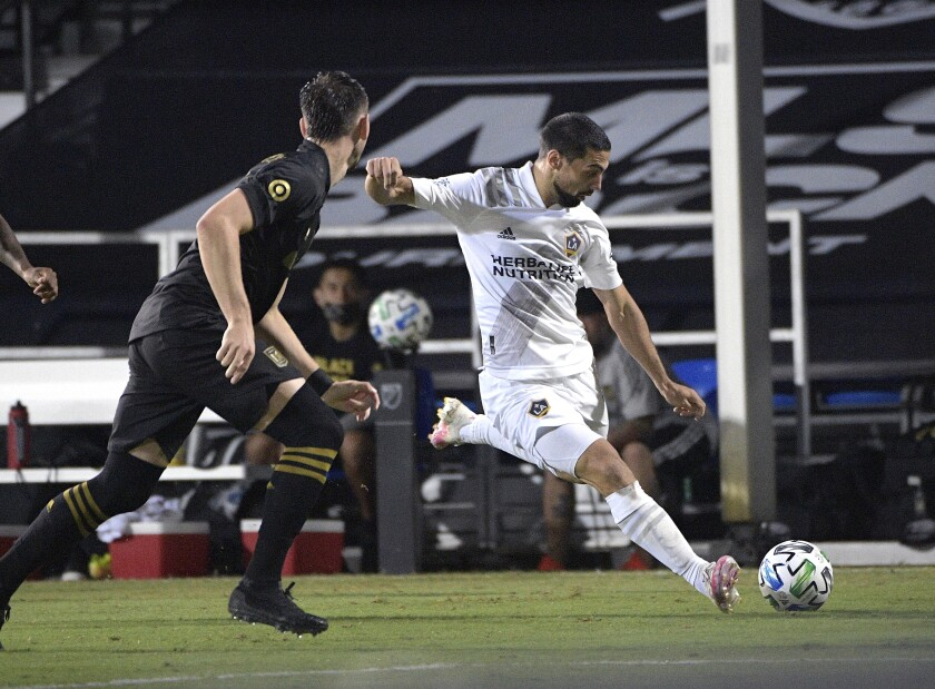 The Galaxy's Sebastian Lletget prepares to send a crossing pass to a teammate.