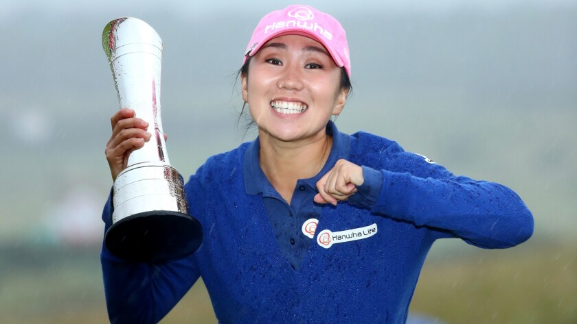 I.K. Kim celebrates after receiving the winner's trophy at the Women's British Open on Sunday.