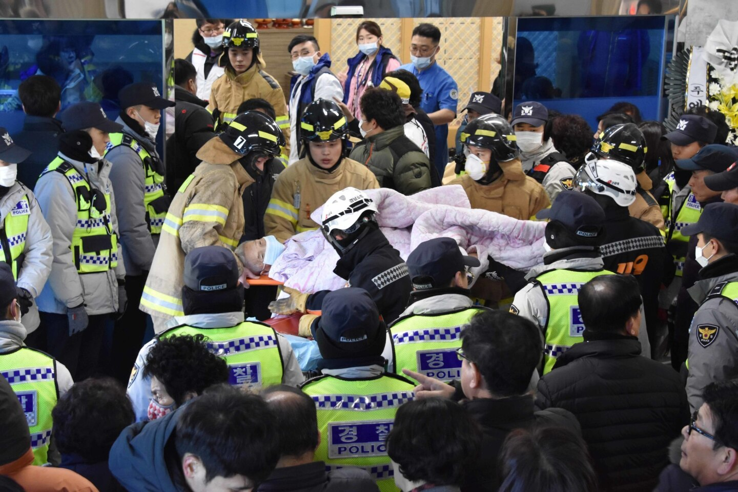 Firefighters carry a victim after the hospital fire in Miryang, South Korea.