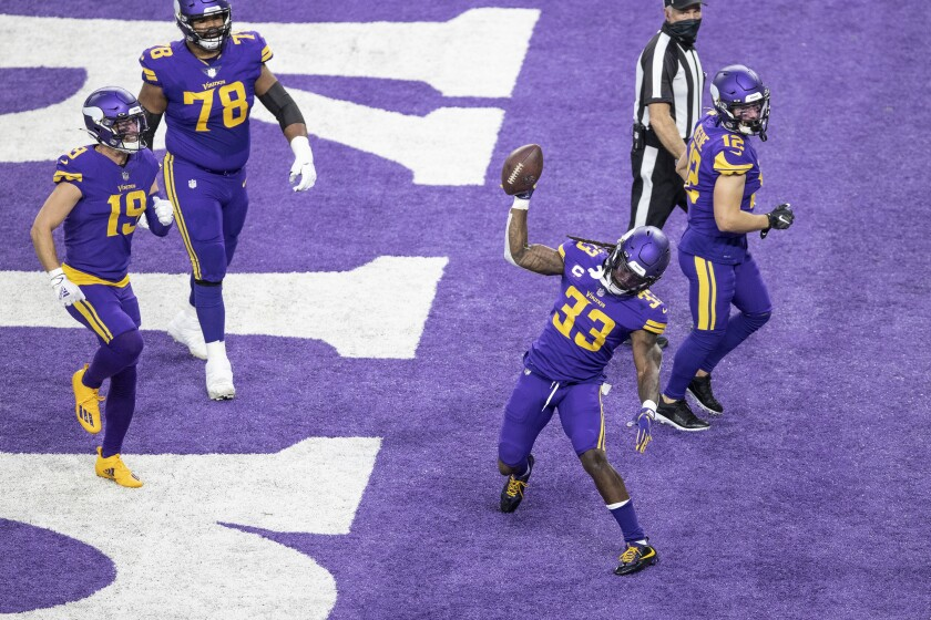 Minnesota Vikings running back Dalvin Cook (33) spikes the football after scoring on a 2-yard run against the Dallas Cowboys during an NFL football game in Minneapolis, Sunday, Nov. 22, 2020. (Jerry Holt/Star Tribune via AP)