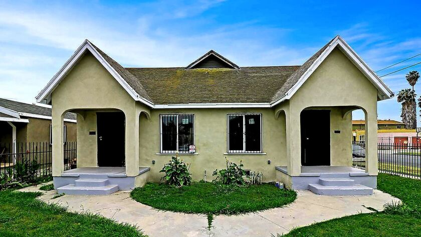 SOUTHWEST L.A.: This remodeled duplex full of bright living spaces is down $49,000 from its original