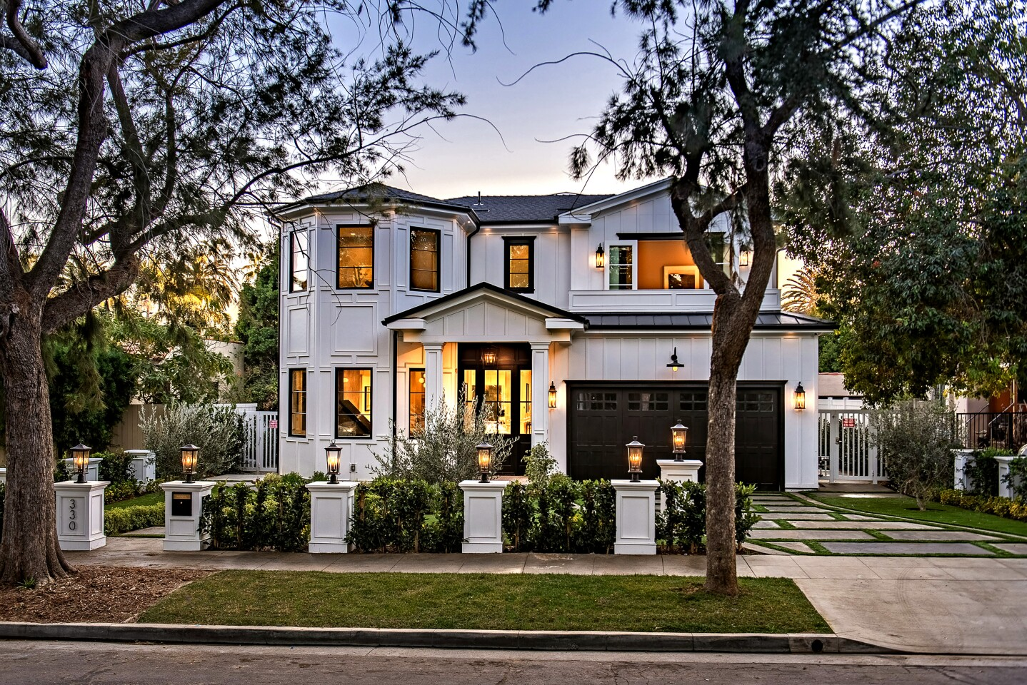 Listed for $8.899 million, the newly built home sits on a tree-lined street in the desirable North of Montana area of Santa Monica. Influenced by East Coast and traditional design styles, the two-story features crisp white walls, detailed wainscoting and multiple fire features. Features of home include an elevator, a media room and a wine cellar. A wet bar fills a side wall in the family room.
