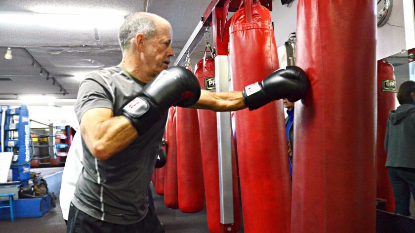 Don Janssen, 64, of Solana Beach, who suffers from Parkinson's disease, practices kickboxing at Rock Steady in Encinitas.