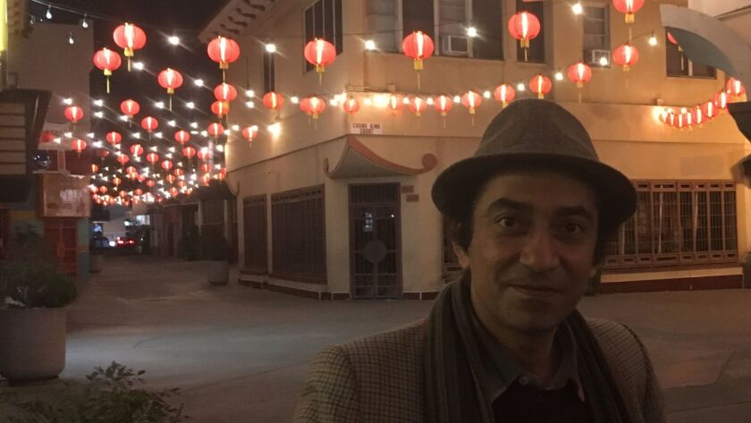 Poet Mohsen Emadi lingers outside of his Los Angeles reading on Chung King Road.