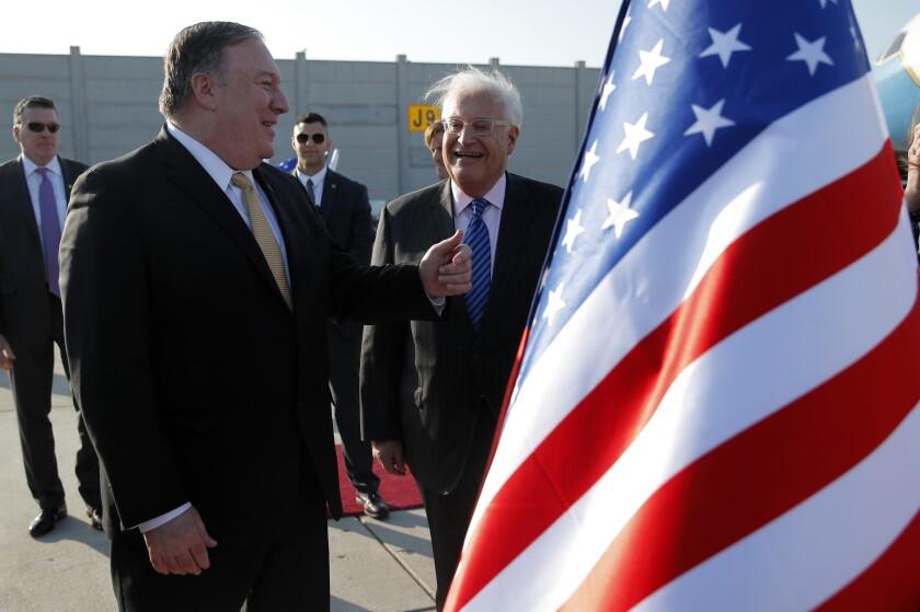 Secretary of State Michael R. Pompeo, left, meets U.S. Ambassador to Israel David Friedman after landing in Tel Aviv in 2019