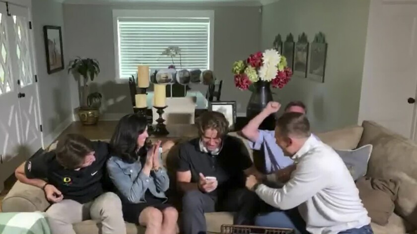 Former Oregon quarterback Justin Herbert is surrounded by his family during the 2020 NFL draft.