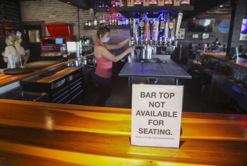 File photo-- The bar top is not available for seating at Eastbound Bar and Grill on Thursday, Sept. 24, in Lakeside.