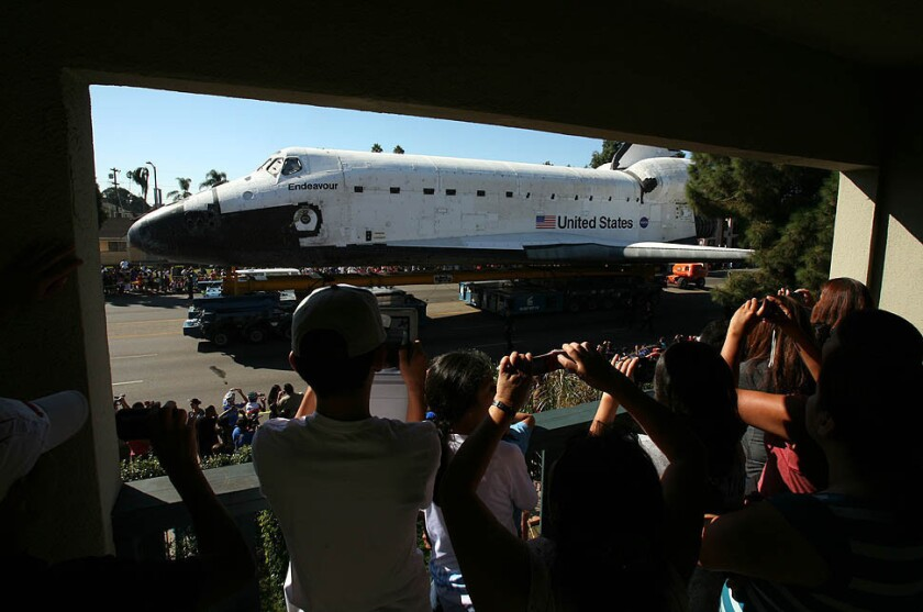 San Fernando Valley roundup: Endeavour lands at Exposition Park, Police book auto theft suspect in Canoga Park, North Hollywood teachers go 'Gangnam Style'