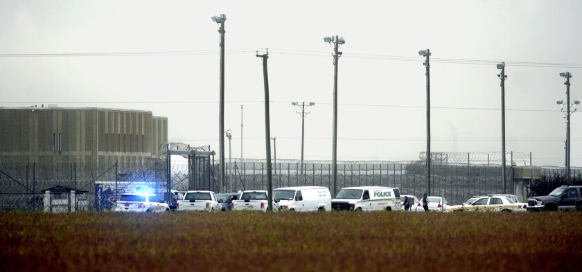 In this photo, police vehicles are seen outside Pasquotank Correctional Institution in Elizabeth City, N.C