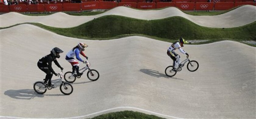 Gold medalist Mariana Pajon, right, of Colombia, leads Magalie Pottier, of France, center, and New Zealand's silver Medalist, Sarah Walker, left, in a a BMX cycling women's semifinal run during the 2012 Summer Olympics in London, Friday, Aug. 10, 2012. Pajon, a former world champion, has won the women's BMX competition at the London Olympics, giving Colombia its first gold of the games. (AP Photo/Christophe Ena)