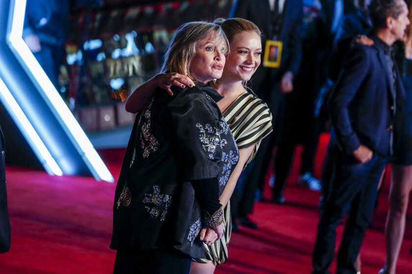 """Carrie Fisher and her daughter, Billie Lourd, attended the premiere of 2015's """"Star Wars: The Force Awakens"""" together in Hollywood. Lourd acts in the final three movies of the nine-part saga."""