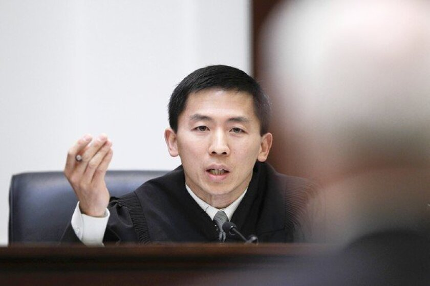 "California Supreme Court Justice Goodwin Liu addresses attorney George Waters during a hearing in San Francisco last January. Gerald Uelman, a law professor at Santa Clara University, describes the 41-year-old Liu's early record as ""a paragon of judicial restraint."""