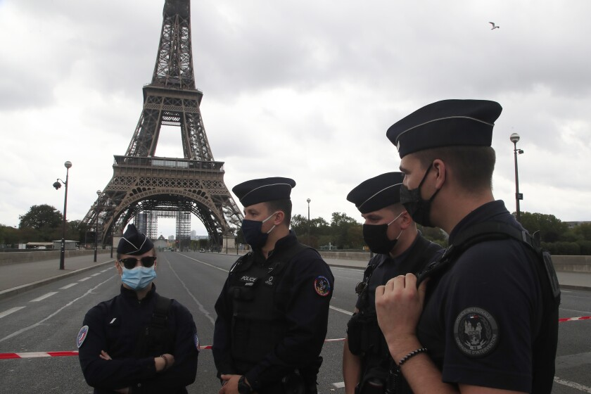French police officers secure the bridge leading to the Eiffel Tower.