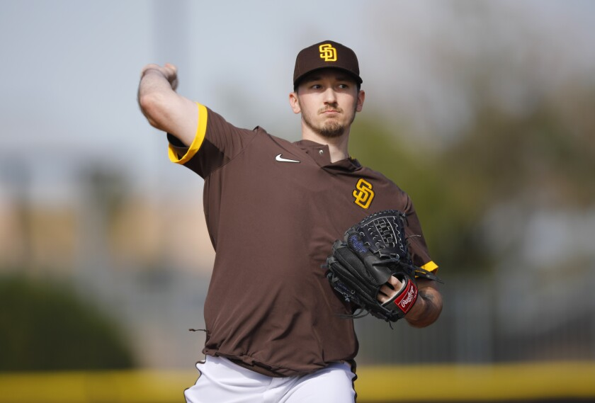 Padres pitchers Zach Davies throws during a spring training practice in February.