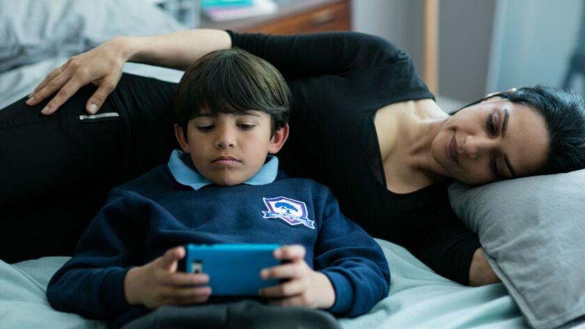 "Archie Panjabi as Mona Shirani and Dante Patel as her son, Sammi, in Sundance Now's ""Next of Kin."""