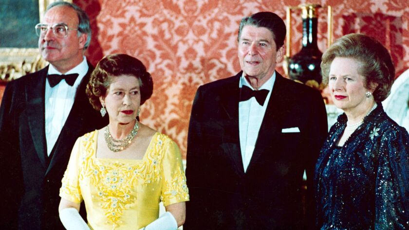 From left in 1984: West German Chancellor Helmut Kohl, England's Queen Elizabeth, U.S. President Ronald Reagan and Britain's Prime Minister Margaret Thatcher at Buckingham Palace. Reagan is the subject of a new biography.
