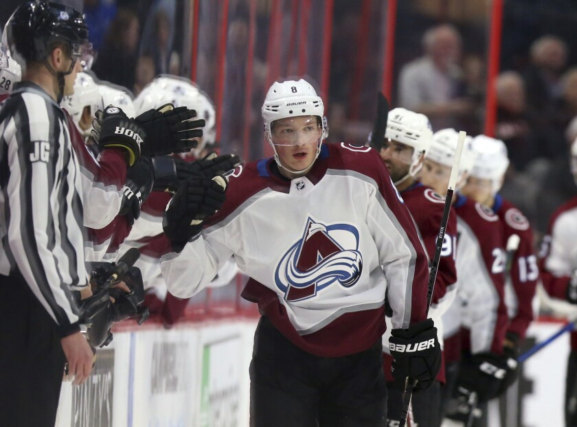 Colorado Avalanche's Cale Makar (8) celebrates his goal with teammates during second-period NHL hockey game action against the Ottawa Senators in Ottawa, Ontario, Thursday, Feb. 6, 2020. (Fred Chartrand/The Canadian Press via AP)
