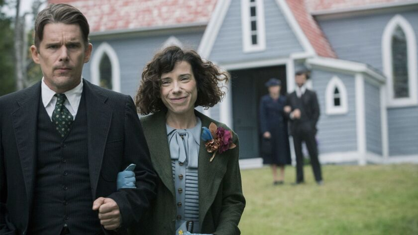 "Ethan Hawke as Everett Lewis and Sally Hawkins as Maud Lewis in the film ""Maudie."""