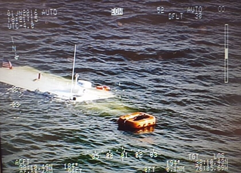 In this June 1, 2016 aerial photo released by the Maryland State Police, a charter boat belonging to the Chesapeake Bay Foundation lies in the Chesapeake Bay after sinking near Wingate, Md. A good Samaritan rescued more than 20 people, including schoolchildren, after the vessel sank Wednesday eveni