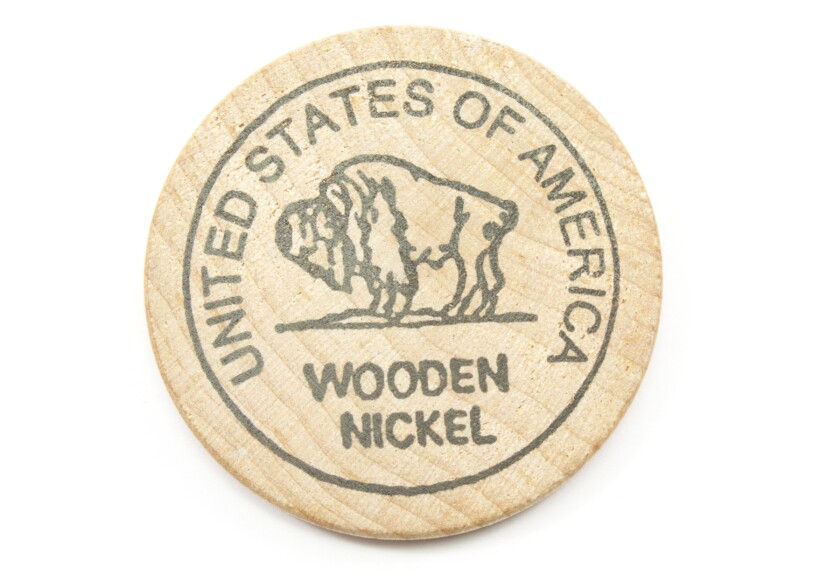 a wood nickel with United States of America and buffalo on it