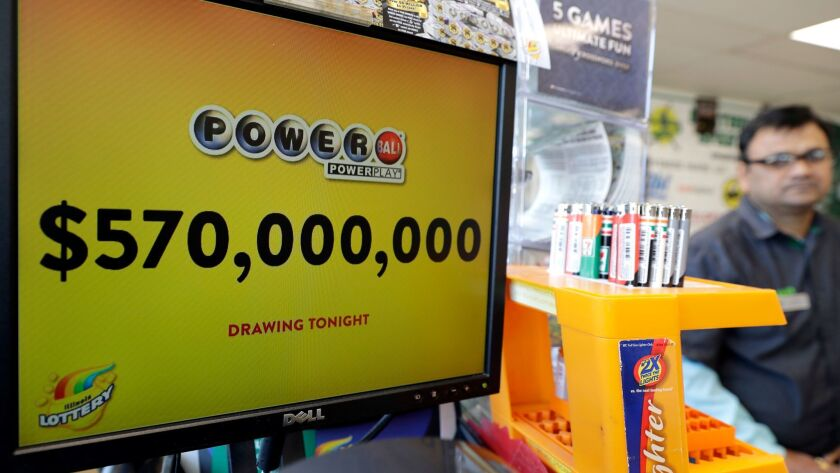 A convenience store in Chicago displays a Powerball sign Saturday.