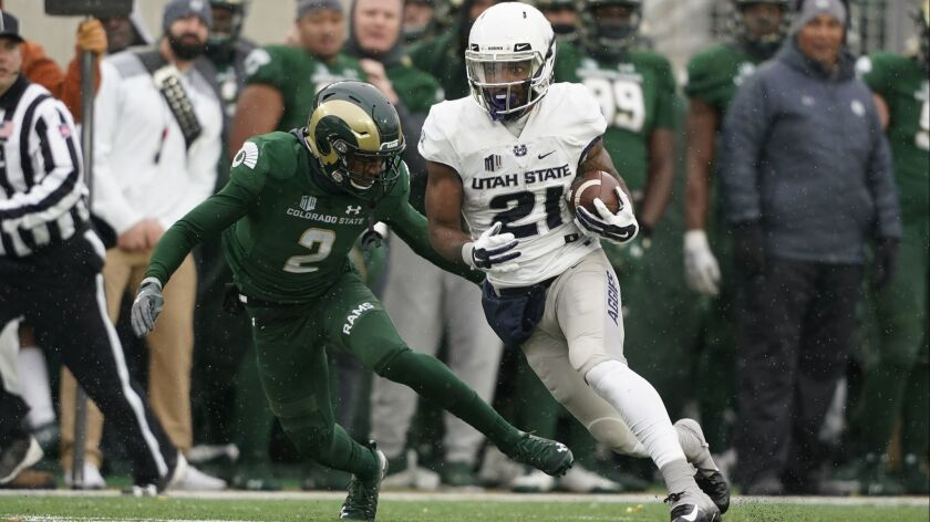 Utah State wide receiver Jalen Greene runs during an NCAA football game between Colorado State and U
