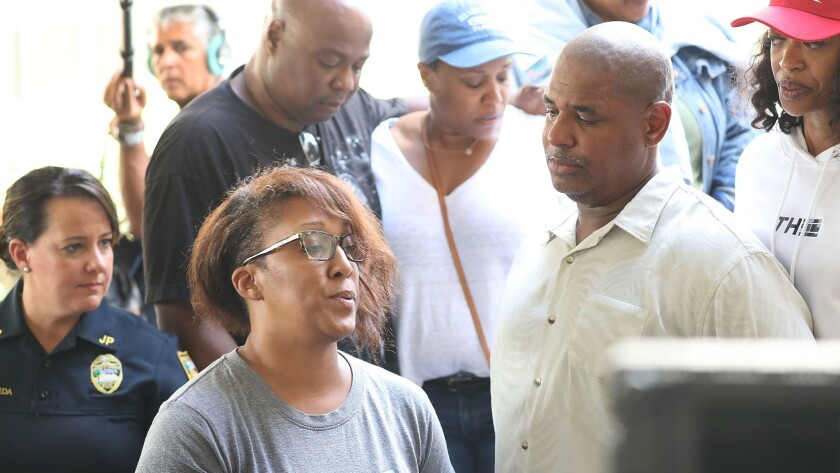 Relatives of Elijah Clayton address the media on Monday after he was killed during a shooting at GLHF Game Bar at the Jacksonville Landing the day before in Jacksonville, Fla.