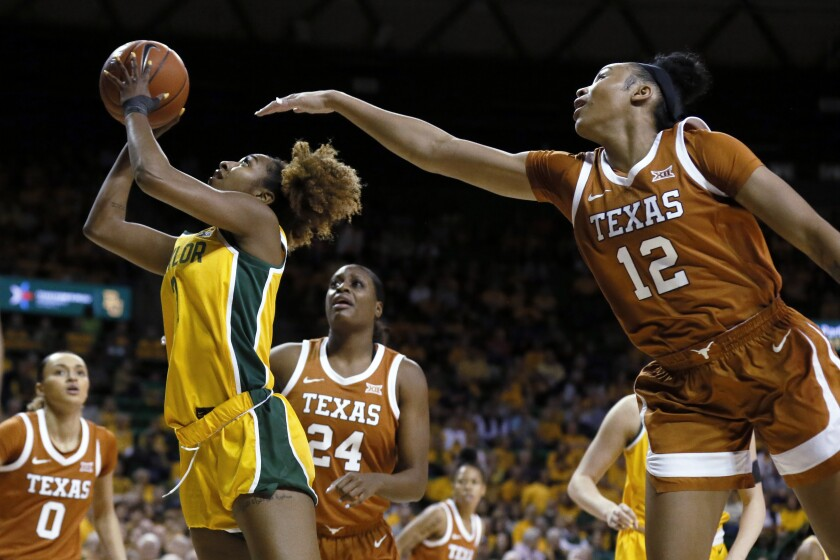 Baylor guard DiDi Richards, left, shoots after getting past Texas guard Jada Underwood, right, during the first half of an NCAA college basketball game Thursday, March 5, 2020, in Waco, Texas. (AP Photo/Ray Carlin)