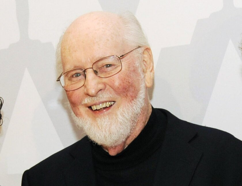 """FILE - In this July 21, 2014 file photo, composer John Williams poses at the Academy of Motion Picture Arts and Sciences event """"Behind the Score: The Art of the Film Composer"""" in Los Angeles. The force is strong with the Boston Pops in 2016. The beloved orchestra is announcing its spring concert sc"""