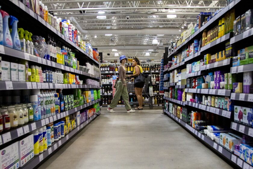 Customers browse aisles at the La Mesa BevMo, which has been converted into a local distribution hub for Gopuff.